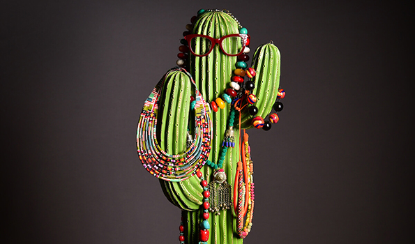 A selection of necklaces arranged on a cactus
