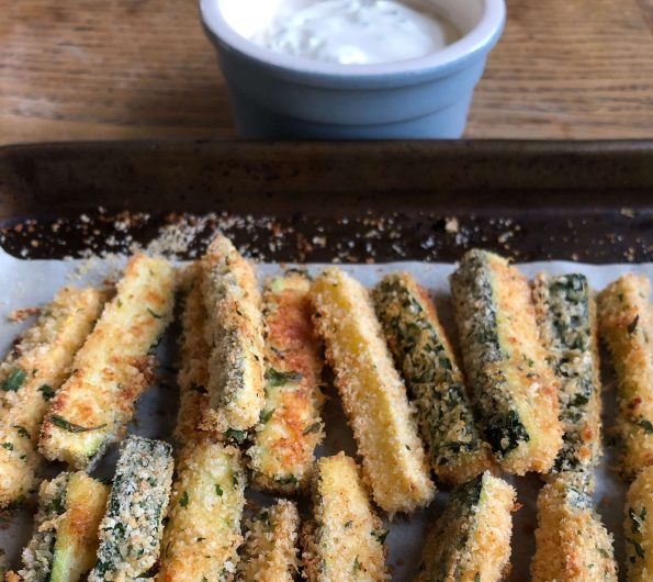 Crispy baked courgette fingers with sour cream and chive dip