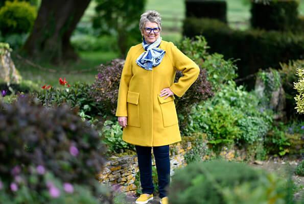 Prue wearing yellow coat from Zara